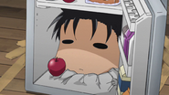 Ogino poking from the fridge