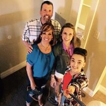 Kendall with family and selfie-stick 2015-04-04