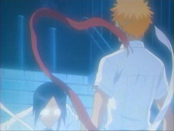 File:Uryu grabs Ichigo's spirit ribbon.jpg