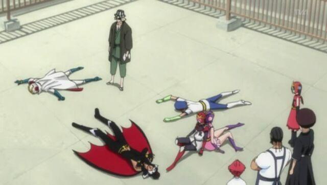 File:Urahara puts Kon and the humans to sleep.jpg