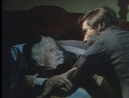 Quentin attempts to force Edith to reveal the secret