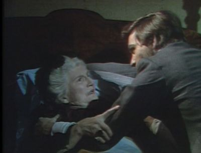 File:Quentin attempts to force Edith to reveal the secret.jpg