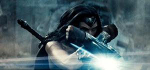 Wonder Woman holds up her gauntlets