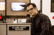 Clark Kent at his Daily Planet desk