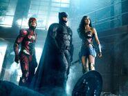 The Flash, Batman and Wonder Woman staring