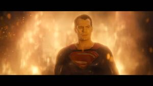 Superman stands in the flames at the Capitol