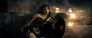 Wonder Woman leaning against rubble