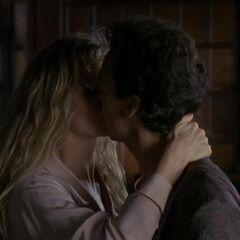 Vicki and Bruce kiss.