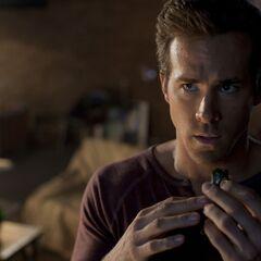 Hal Jordan putting the ring on.
