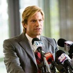 Aaron Eckhart as Harvey Dent.