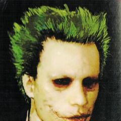 Early concept art of the Joker from <i>The Art Of The Dark Knight</i>.