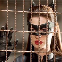 Catwoman looking at Batman after he is beaten by Bane.