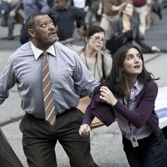 Perry White and Jenny Jurwich running from the destruction of <i>The Daily Planet</i>.