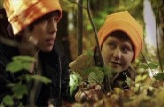 File:Adam and Eli hiding in a bush.jpg