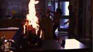 Alli grabbing fire-extinguisher