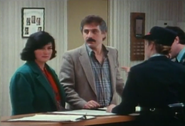 File:Mr g and mrs g getting voula from the police station.png