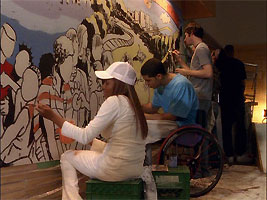File:The mural being painted.jpg