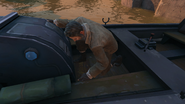 Samuel adjustes his boat