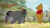 Winnie the Pooh has giving Eeyore a Poohckoo clock tail