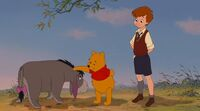 Winnie-the-Pooh-and-Christopher-Robin-help-Eeyore