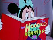 Minnie reading a scary book