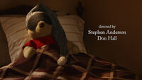Winnie the Pooh is a stuffed toy bear sleeping in bed