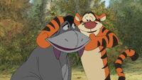 Tigger is making Eeyore smile