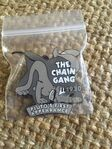 Chain gang pin