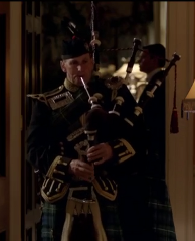 File:BagpipePlayerS3E9.png