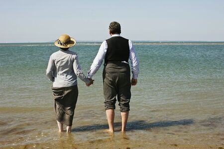 Carson Hughes Beach holding hands