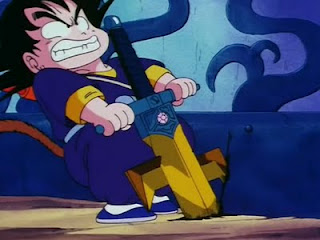 File:Goku trying to pull out Shula's sword.png
