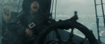 File:350px-Barbossa at the wheel.png