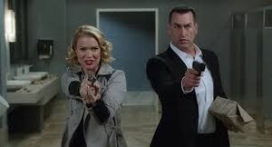 Adele with Captain Lippincott attempting to steal the invention