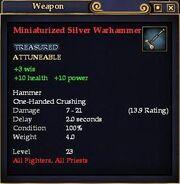 Miniaturized Silver Warhammer