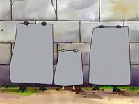 Archivo:EP515 Team Rocket disfrazados de pared.png
