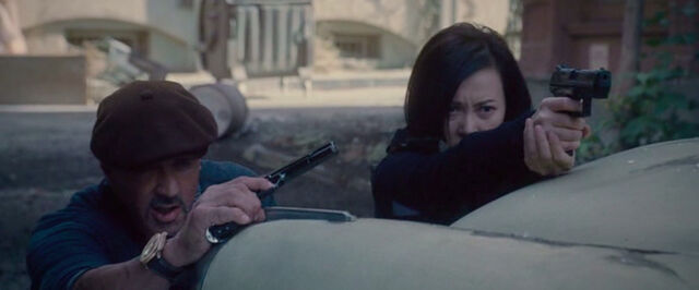 File:Expendables 2 Maggie takes aim.jpg