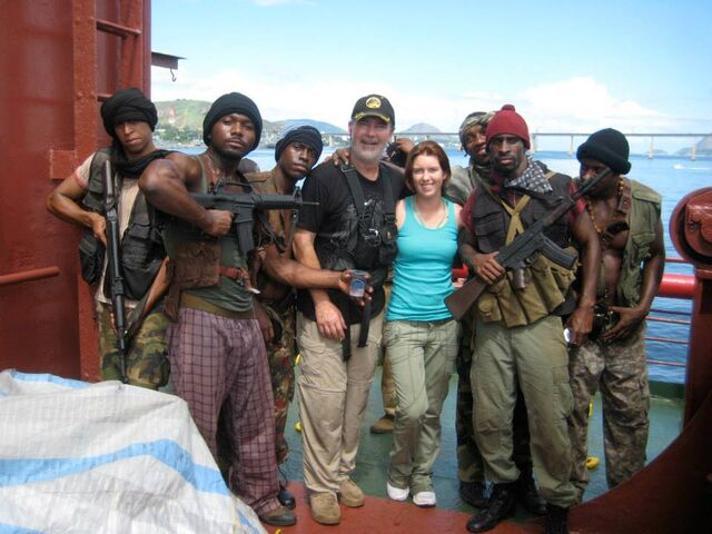 File:Expendables stunt guys Andy Gill & Kelly Meghan Gill along with the pirate stunt team.jpg