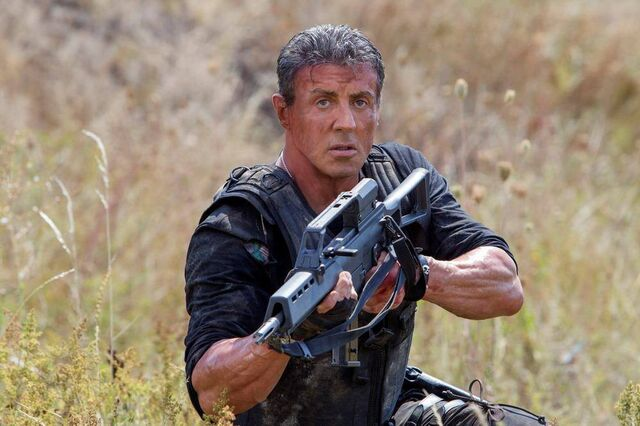 File:EX3- Stallone as Barney Ross ready for action.jpg