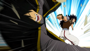 Gajeel punches Rogue away