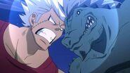 Elfman headbutts a Lizardmen