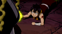 Romeo uses his Yellow Flame to save Lucy