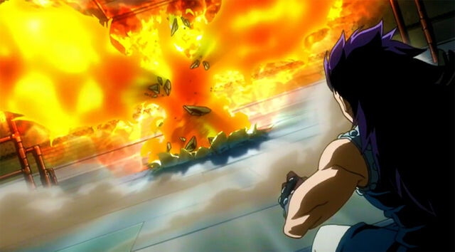File:Natsu appears in front of Gajeel covered by his Flames.jpg