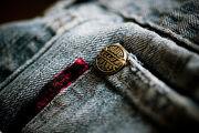 375px-Closeup of copper rivet on jeans