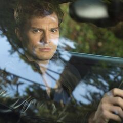 Christian driving a car in movie