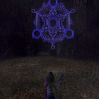 Shiva appearing out of her glyph.