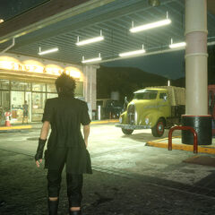 Noctis and Prompto at a gas station.