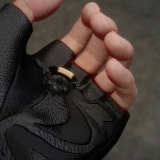 Noctis holds the ring in his palm in <i><a href=