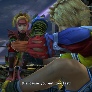 Rikku gave food to Tidus.