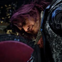 Ardyn smirks as he stands near King Regis's empty throne.