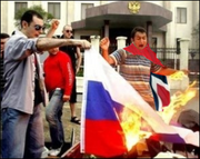 Burning Russian Flag outside embassy in Oslo